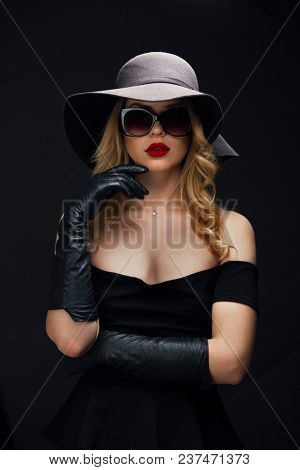 Portrait of young woman in hat ,gloves