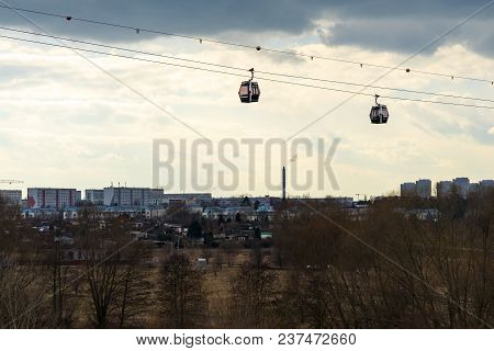 Wagons Of A Cable Car Over The Natural Landscape.