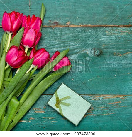Tulip Bouquet And Small Gift Box On Green  Wooden Background, Copy Space