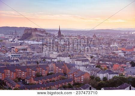 Edinburgh cityscape with Edinburgh Castle in background at sunset as viewed from the Ethe Arthurs Seat hill, Scotland, UK