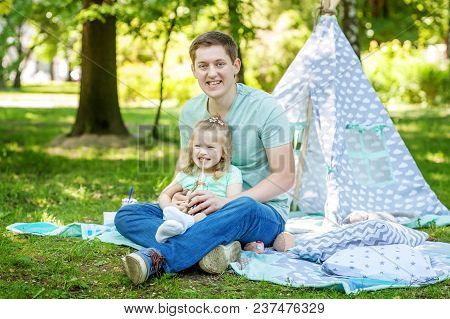 Beautiful Little Preschool Girl Playing With Dad In The Park.the