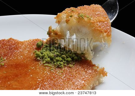 Kunefe, kadayif and made cheese and served hot as a Turkish dessert poster