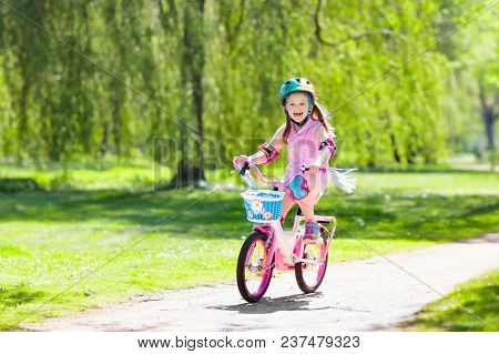 Child On Bike. Kids Ride Bicycle. Girl Cycling.