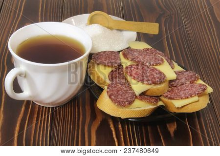 Sandwiches With Cheese And Smoked Sausage, And Tea