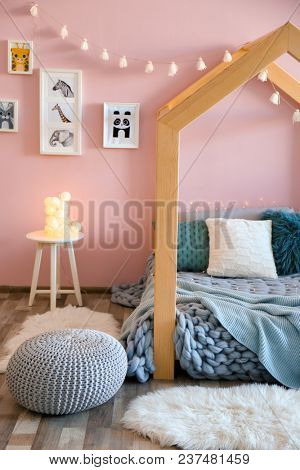 Children's room interior with comfortable bed