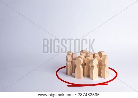 A Group Of People Are Standing In A Circle On A White Background. Wooden Figures. Community, Party.
