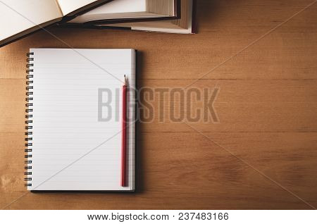 Overhead Of Desk With Opened Notebook, Textbooks And Pencil
