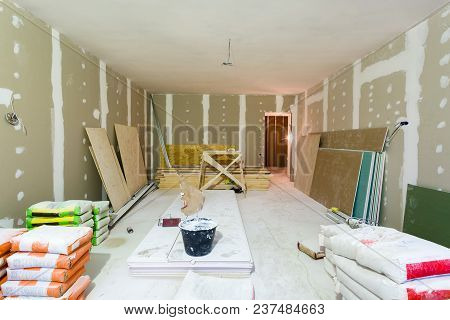 Materials For Construction Putty Packs, Sheets Of Plasterboard Or Drywall In Apartment Is Under Cons
