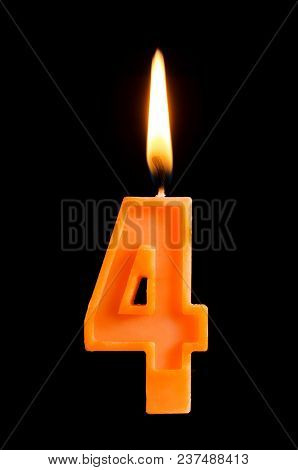 Burning Birthday Candle In The Form Of 4 Four Figures For Cake Isolated On Black Background. The Con