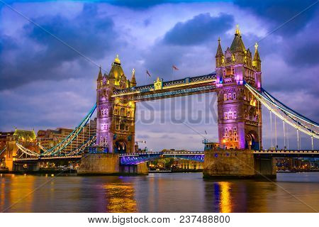 London, The United Kingdom Of Great Britain: Night View Of The Bridge Tower After Sunset. A Combined