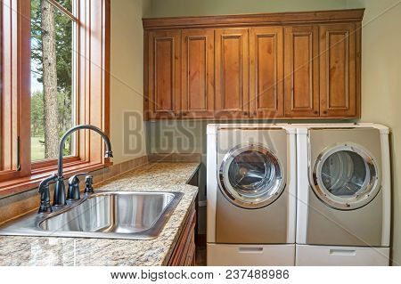 Huge Laundry Room With White Washer And Dryer