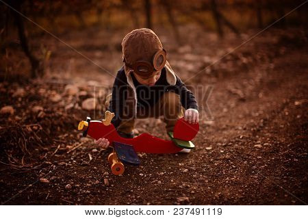 Happy Child Toddler Boy Playing With Toy Airplane And Dreaming Of Becoming A Pilot