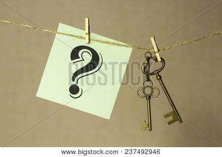 Vintage Key Hanging On A Rope On A Gold Background, Next Sticker With Question Mark