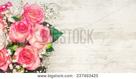 A Bouquet Of Beautiful Wedding Flowers On A White Wooden Background. Place For Text