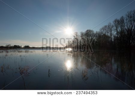 Sunset At The Overflow Bank Of The Rhine Near Wageningen On A Sunny Cold Winter Day In January