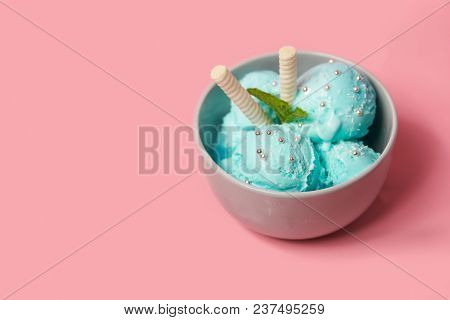 Pictachio Ice Cream With Waffle Sticks, Several Leaves Of Mint In Bowl On Pink Background. Copy Spac