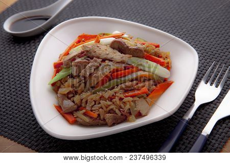 Delicious Chinese Chicken With Fried Rice And Carrots, Onion, Ginger, Fresh Chives