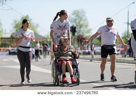 Belgrade, Serbia - April 21, 2018: Disabled Woman In Wheelchair, Enjoying Race During 31st Belgrade