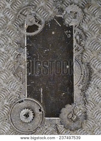 dark metal blank old label in gears on industrial background
