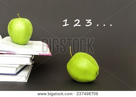 Concept Back To School, Numbers 1, 2, 3, Two Green Apples, Open Books On Gray Background