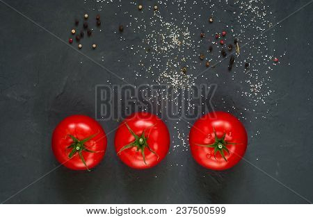 Dark Background With Spices And Fresh Red Tomatoes, Close-up, Top View, Concept Of Cooking Ketchup,