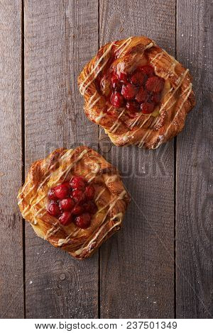 Puff Pastry Tarts With Raspberries On Wooden Background. Top View