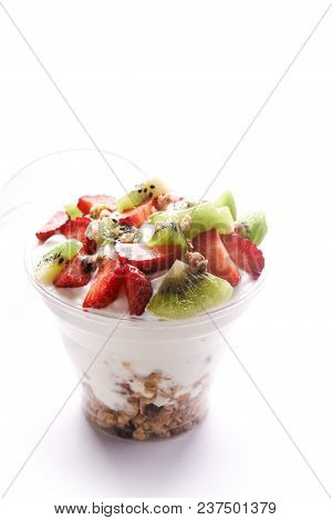 Granola With Yoghurt And Berries In Bowl Over White Background