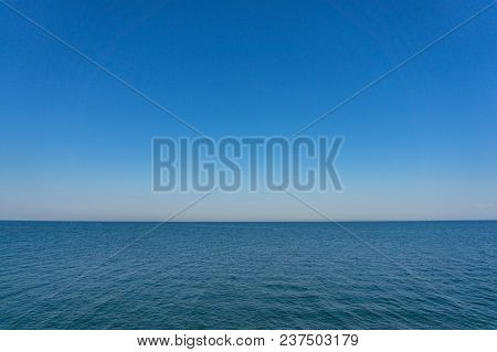 Endless Vast Ocean, Sea And Clear Blue Sky. Tranquil Nature Background
