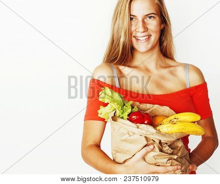Young Pretty Blond Woman At Shopping With Food In Paper Bag Isolated On White Background, Lifestyle