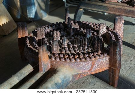 Round Rusty Metallic Gas Burner On Wooden Surface. Grunge Detail