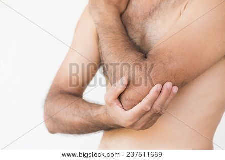 Closeup Man Elbow And Arm Pain And Injury On White Background. Health Care And Medical Concept.