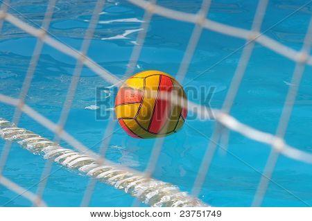water polo ball through goal net