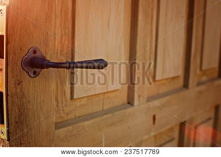 Door Handle In The Interior. Knob Close-up Elements. Open And Closed Light Wooden Doors In In Modern