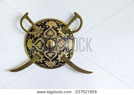 Decorated Round Sword And Shield Isolated In White Background With Copy Space For Text. Antique Arte