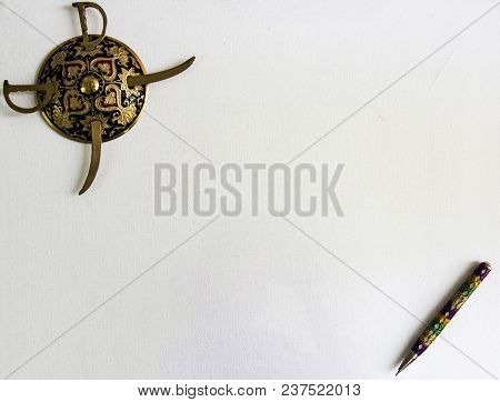 Decorated Round Sword And Shield And Pen Isolated In White Background With Copy Space For Text.antiq