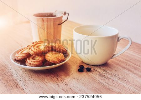 Coffee In White Cup And Cookie On White Plate On Wooden Table For Drink In Morning,coffee Time Vinta