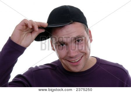 Young man With Hand In Cap