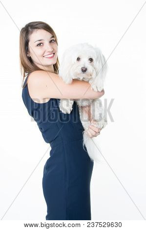 Beautiful Young Woman With Little Dog In Arms On White Background