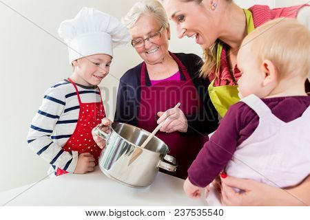 Happy family cooking in multigenerational household