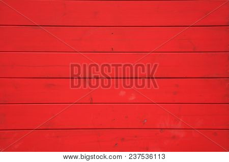 Wooden red background with horizontal planks. Vintage empty surface, close up view.