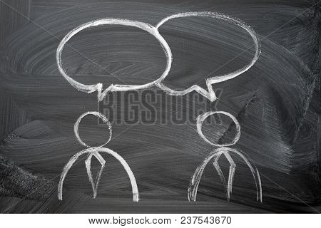 Speaking Of People. Two Man In Ties Silhouette And Speak Bubbles Chalk Hand Drawn On The Blackboard.