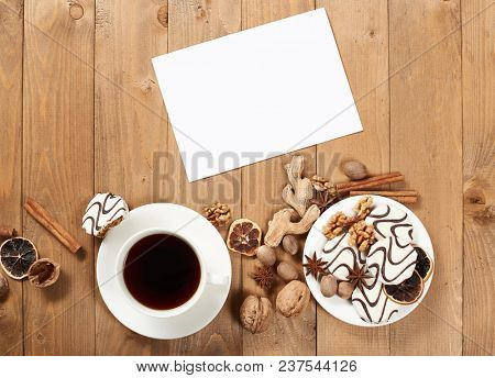 Cup of coffee and cookies on wooden background, spice and decoration, blank sheet for text, top view, retro style