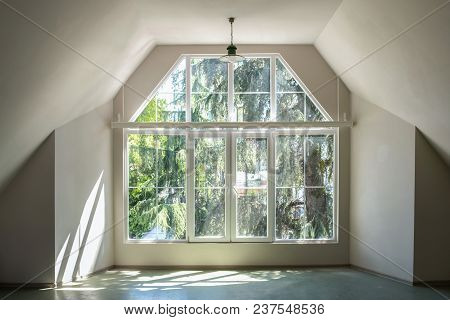 Sun Light Through The Large White Windows In Empty Interior