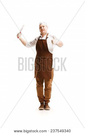 Smiling Happy Butcher Posing With A Cleaver Isolated On White Studio Background With Sign Ok. The Yo