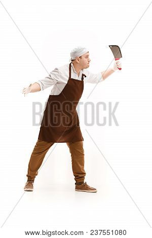 Angry Aggressive Butcher Posing With A Knife Isolated On White Studio Background. The Young Caucasia