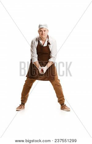 Angry Aggressive Butcher Swinging With A Knife Isolated On White Studio Background. The Young Caucas