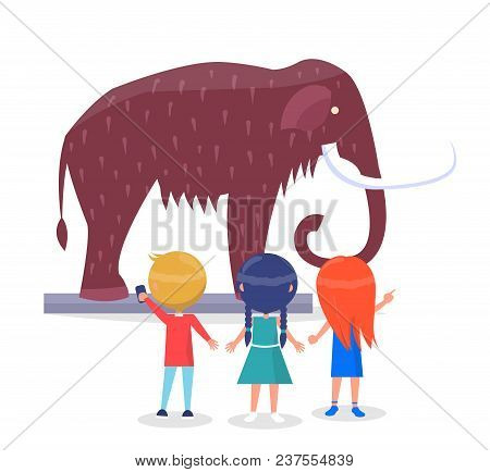 Excited Boys And Girls Admiring Model Of Giant Mammoth With Long Curved Tusks In Museum Cartoon Styl