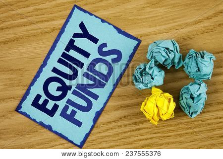 Word writing text Equity Funds. Business concept for Investors enjoys great benefits with long term investment written Sticky Note paper wooden background Paper Balls next to it. poster