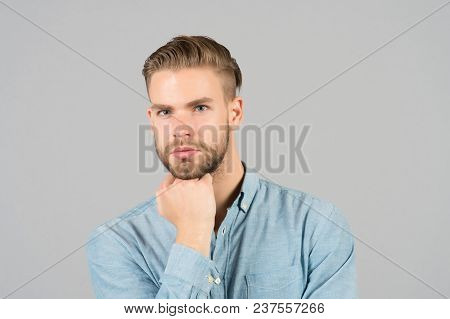 Guy With Stylish Hair Touch Beard With Hand. Bearded Man With Healthy Young Skin. Macho With Unshave