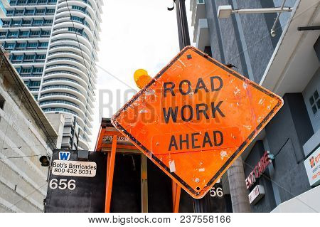 Miami, Usa - October 30, 2015: Construction Sign On City Road. Road Work Ahead Warning And Safety. T
